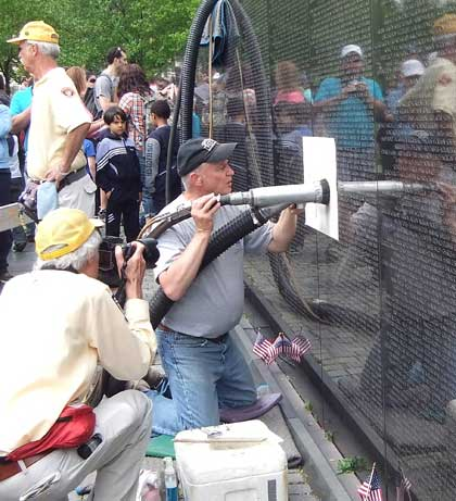 adding a name to the Vietnam Veterans Memorial